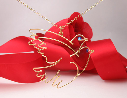"Pablo Picasso ""Two Doves"" pendant in wire"