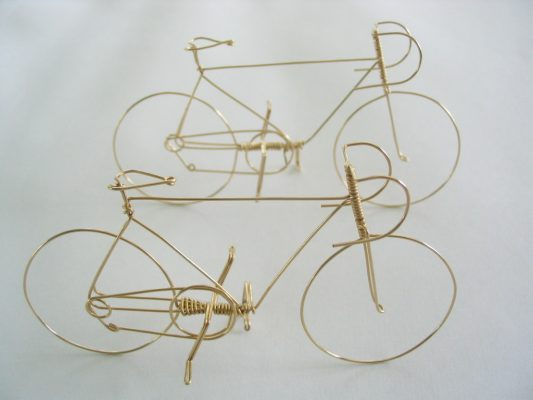 "Bicycle is handmade from a single piece of wire, 2"" high and 3"" long."