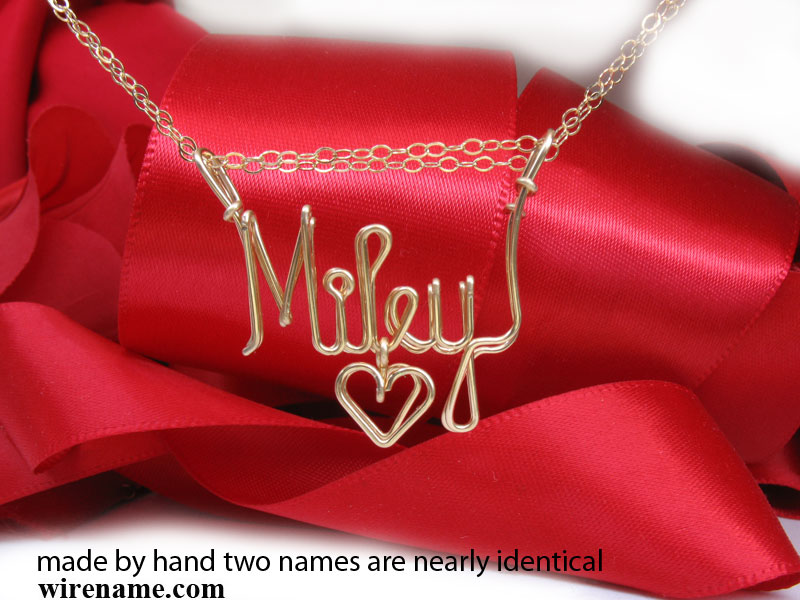 Made by hand two names are identical. Wire gold necklace.